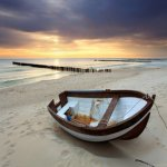 Boat on beautiful beach in sunrise © Tomas Sereda - Fotolia.com